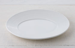 Empty white ceramic plate Royalty Free Stock Photos