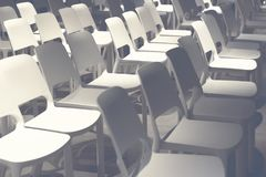 Empty white chairs arranged before the performance, conference. Defocus. Toned photo. Selective focus Stock Photos