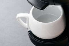 Empty white coffee cup in the coffee machine, close-up Royalty Free Stock Photography