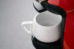 Empty white coffee cup in the coffee machine Royalty Free Stock Images