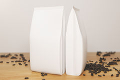 Empty white coffee packages Stock Images