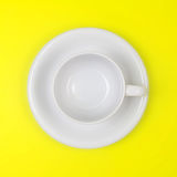 Empty white coffee or tea cup on vibrant color background Royalty Free Stock Image