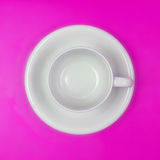 Empty white coffee or tea cup on vibrant color background Stock Image