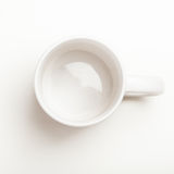 Empty white coffee, tea mug, cup, top view. Top view on empty white coffee or tea mug or cup. Studio shot from above on white background Stock Photo