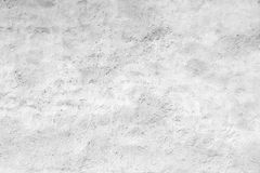 Empty white concrete wall with plaster relief pattern Stock Photo