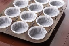 Empty white cup cakes papers ready for baking.  Royalty Free Stock Images