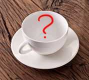Empty white cup with red question mark in it. Royalty Free Stock Photography