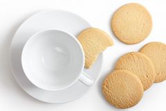 Empty white cup and saucer with shortbread biscuits from above. Royalty Free Stock Photography