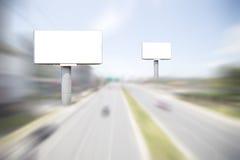 Empty white digital billboard on blur highway road background. Royalty Free Stock Photo