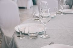Empty white dinner plate on a table royalty free stock images