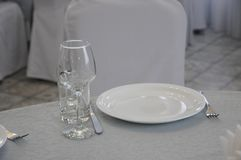 Empty white dinner plate on a table royalty free stock photography