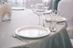 Empty white dinner plate on a table stock photography