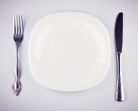 Empty white dish knife and fork Royalty Free Stock Photo