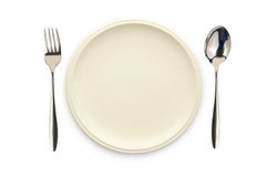 Empty white dish spoon and fork. Top view of empty white dish spoon and fork on white background Stock Photos