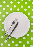 Empty white flat plate with fork and knife Royalty Free Stock Photos