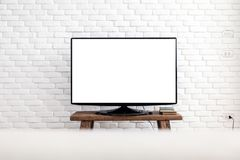 Empty white flat TV screen hanging on a white wall.  stock photo