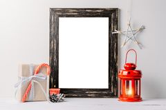 Empty white frame mock up. Black wooden frame mockup with christmas decorations on a white background. Empty white frame mock up. Black wooden frame mockup with royalty free stock images
