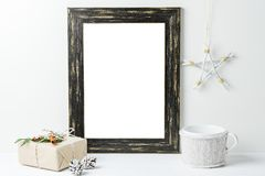 Empty white frame mock up. Black wooden frame mockup with christmas decorations on a white background. Empty white frame mock up. Black wooden frame mockup with stock photos