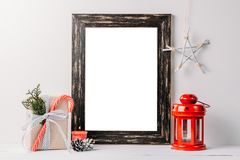 Empty white frame mock up. Black wooden frame mockup with christmas decorations on a white background. Empty white frame mock up. Black wooden frame mockup with royalty free stock image