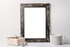 Empty white frame mock up. Black wooden frame mockup with christmas decorations on a white background. Empty white frame mock up. Black wooden frame mockup with royalty free stock photography
