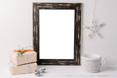 Empty white frame mock up. Black wooden frame mockup with christmas decorations on a white background royalty free stock image