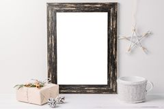 Empty white frame mock up. Black wooden frame mockup with christmas decorations on a white background. Empty white frame mock up. Black wooden frame mockup with stock images