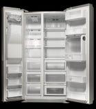 The empty white fridge. On black background Royalty Free Stock Image