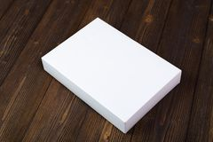 Empty white gift box or tray for mock up on dark wooden table wi Stock Images