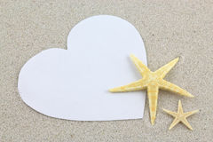 Empty white heart and starfishes on the beach Royalty Free Stock Image