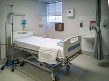 Empty white hospital bed in clean clinic. S royalty free stock images