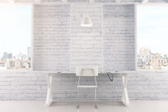 Empty white interior with table, chair, brick wall and windows Stock Photography