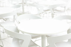 Empty white interior of tables and chairs. Infinity perspective. Cafe, clinic background. Stock Photos