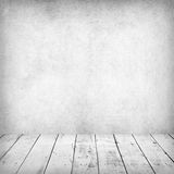 Empty white interior of vintage room. Empty white interior of vintage room without ceiling from gray grunge stone wall and old wood floor. Perfect background Royalty Free Stock Image