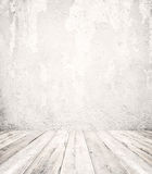 Empty a white interior of vintage room - gray grunge concrete wall and old wood floor. royalty free stock image