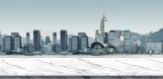 Empty white marble balcony at blur cityscape view building at eventing,Mock up template for display royalty free stock photography