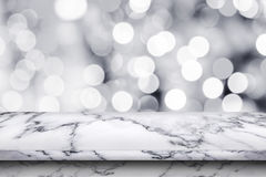 Empty white marble table on abstract bokeh background. For display or montage your products royalty free stock images