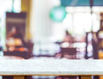 Empty white marble table and blurred cafe bokeh light background Stock Image