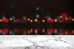 Empty white marble table and bokeh at night light. Stock Photos