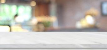 Empty white marble table over blur cafe, restaurant, background,. Product and food display montage Stock Images
