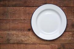 Empty white metal enamel plate Stock Photo