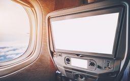 Multimedia screens templeate in seat of airplane near window stock photos