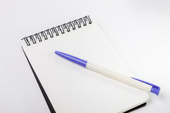Empty white note, pen and blue clip. With white background Royalty Free Stock Images