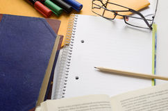 Empty White Notebook Glasses Pencil. White open notebook with pencil, glasses and markers Stock Images
