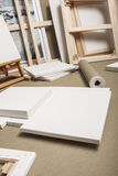 Empty white painter canvases and canvas roll and easel - painter program Royalty Free Stock Photos