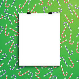 Empty white paper blank over background with Christmas canes Royalty Free Stock Photos