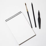 Empty white paper with brush on black and white background Royalty Free Stock Images