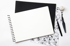 Empty white paper with brush on black and white grangy background Royalty Free Stock Photos