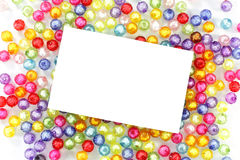 Empty white paper on colorful beads Stock Photography