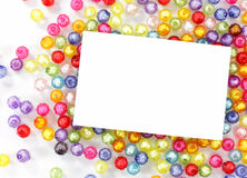 Empty white paper on colorful beads Royalty Free Stock Images