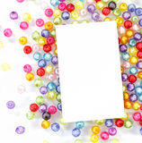 Empty white paper on colorful beads Stock Image